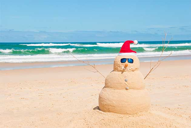 Sand Snowman on the Beach - Best Dive Destinations